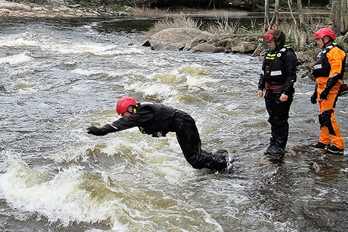 A Canadian Army instructor dives into fast moving water during swift water rescue training on the Shadow River near Parry Sound, Ontario on May 26, 2017.