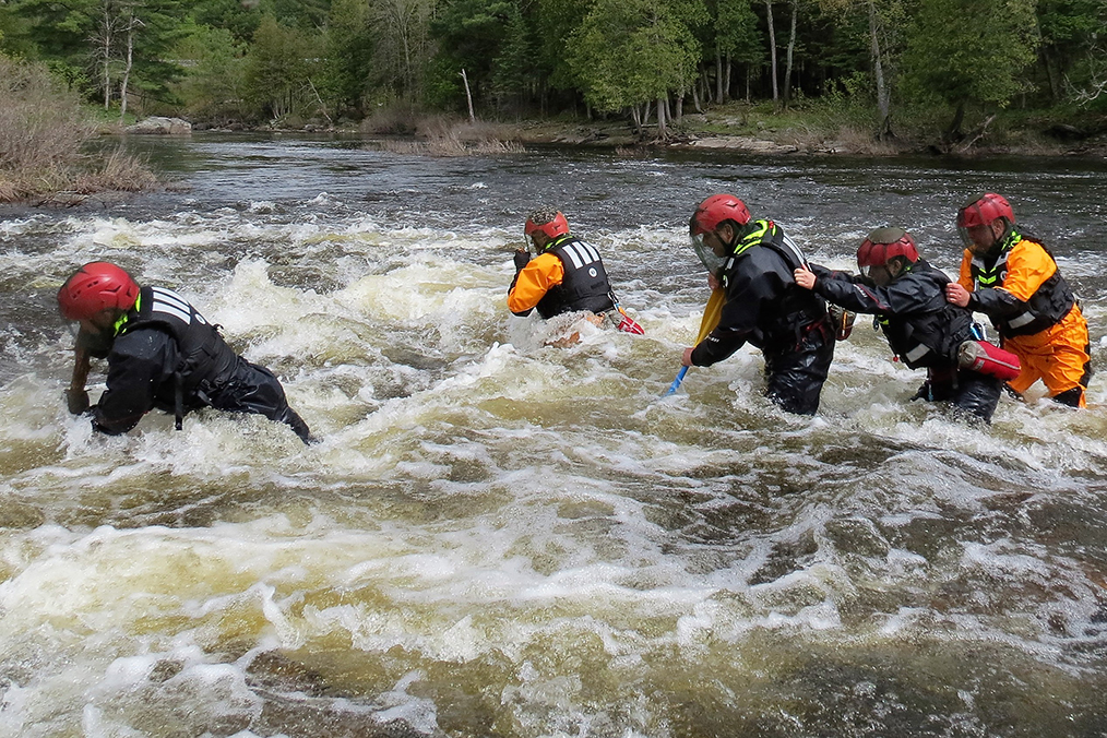 Soldiers learn to move individually and in teams in white water during swift water rescue training on the Shadow River near Parry Sound,  Ontario on May 26, 2017.