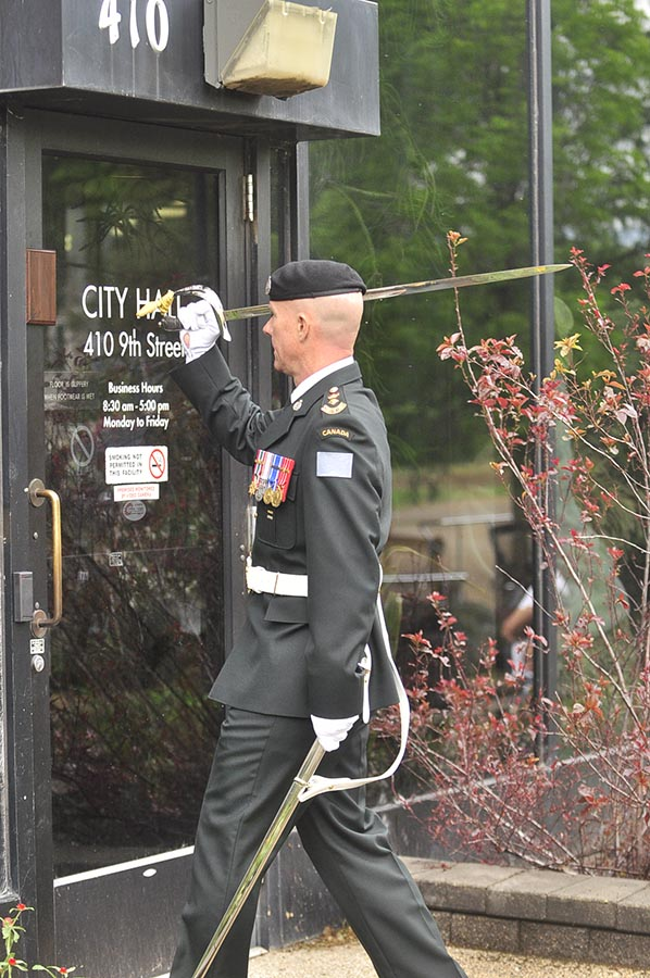 Soldier with sword at doorway