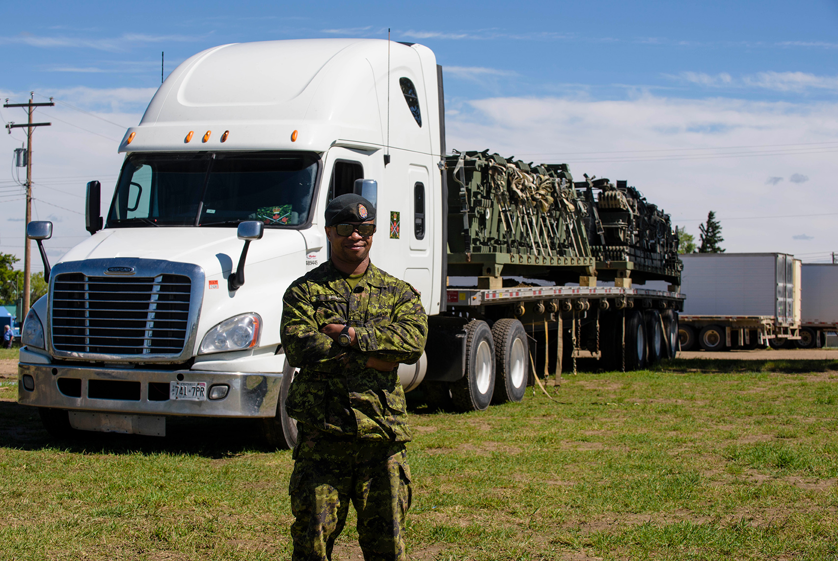 Corporal Shawn Brown prepares to depart Canadian Forces Base Wainwright in Alberta with a load of equipment he was tasked with returning to Petawawa, Ontario. Cpl Brown received training in tractor trailer operation as part of a program that will generate substantial financial savings by reducing the Canadian Army's reliance on civilian contractors for logistical services. Photo: Master Corporal Malcolm Byers, 3rd Canadian Division Support Group Edmonton. ©2017 DND/MDN.