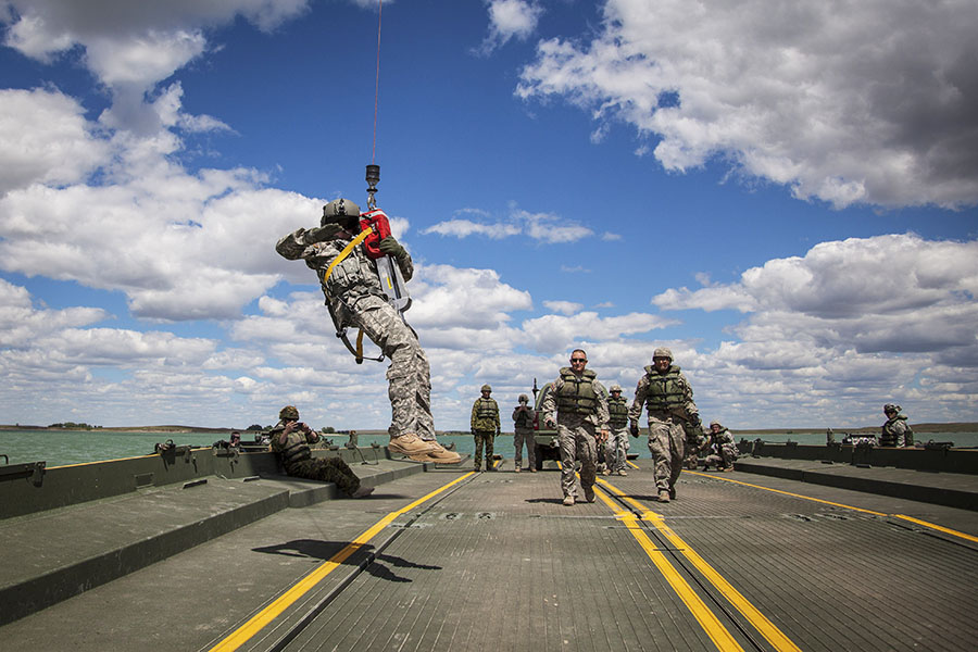 38 Canadian Brigade Group signallers assisted the 200th Engineer Multi-Role Bridge Company, South Dakota Army National Guard, with setting up an Improved Ribbon Bridge and operating bridging boats on the Belle Forche Reservoir in South Dakota during Exercise GOLDEN COYOTE, conducted June 12 to 20, 2017. 