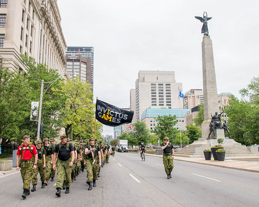 Team Canada Co-Captain, Major Simon Mailloux, marches alongside Joint Task Force Central en route to the Invictus Games