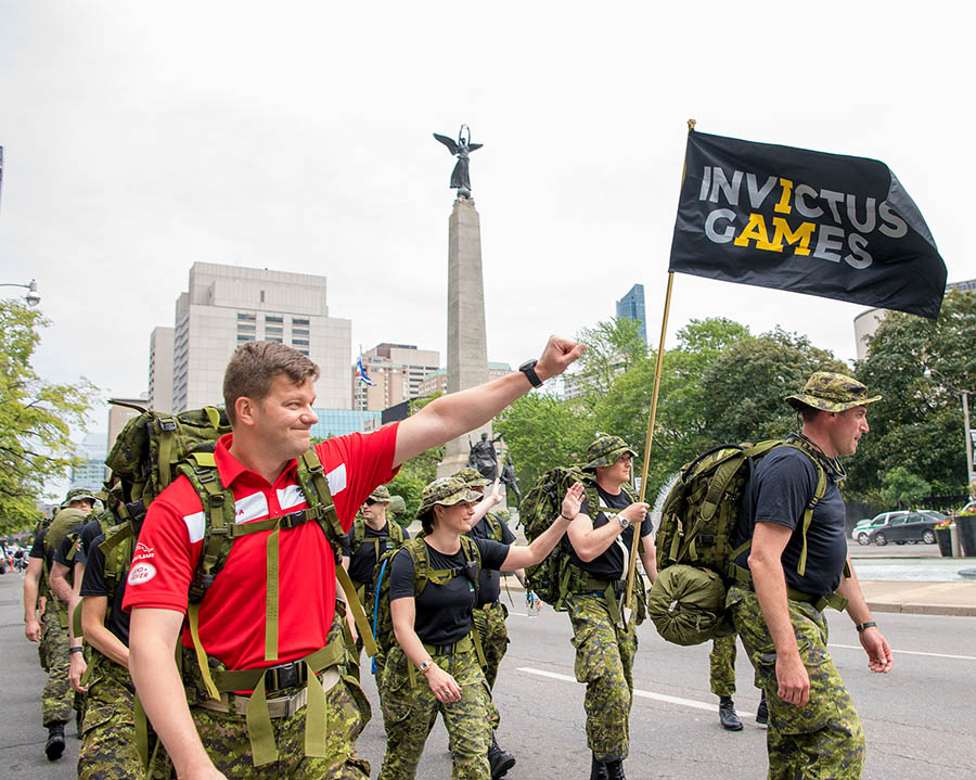 Team Canada Co-Captain, Major Simon Mailloux, marches alongside Joint Task Force Central en route to the Invictus Games 100-day countdown celebration in downtown Toronto on June 15, 2017.
