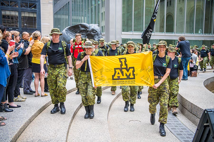 Members of Joint Task Force Central Headquarters march in support of their comrades in arms during the 100-day countdown to the Invictus Games in downtown Toronto on June 15, 2017.