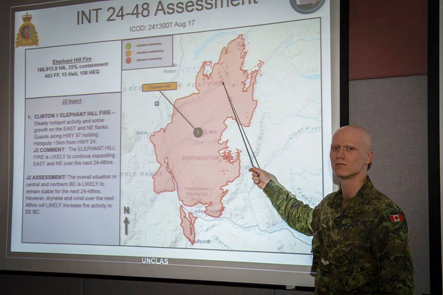 Corporal François-Olivier Lachaine from 4 Intelligence Company in Montreal conducts a briefing during Op LENTUS , the Canadian Army Forces support to civil authorities in British Columbia combating wild fires.