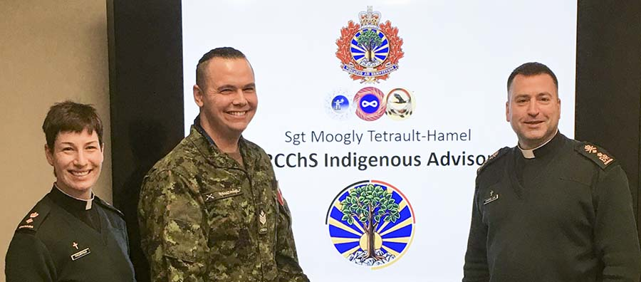 Sergeant Moogly Tetrault-Hamel (centre) with Chaplain General Brigadier-General Guy Chapdelaine (right) and Lieutenant-Colonel Lisa Pacarynuk (left) during a conference on Indigenous Awareness in Ottawa on March 16, 2017.  Photo: courtesy Sergeant Moogly Tetrault-Hamel.
