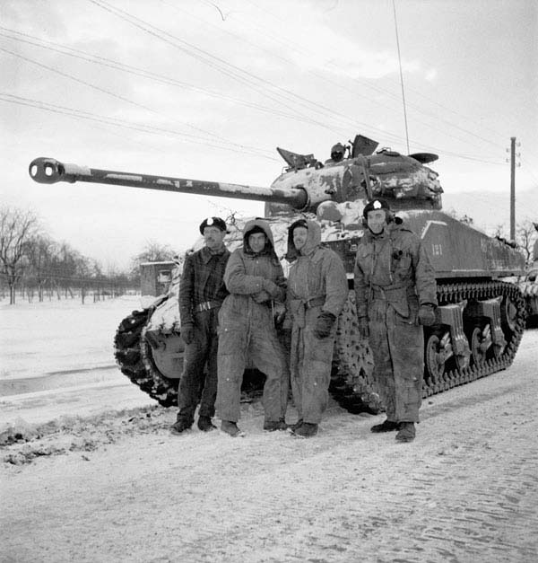 A tank crew from the 1st Hussars with their Sherman tank