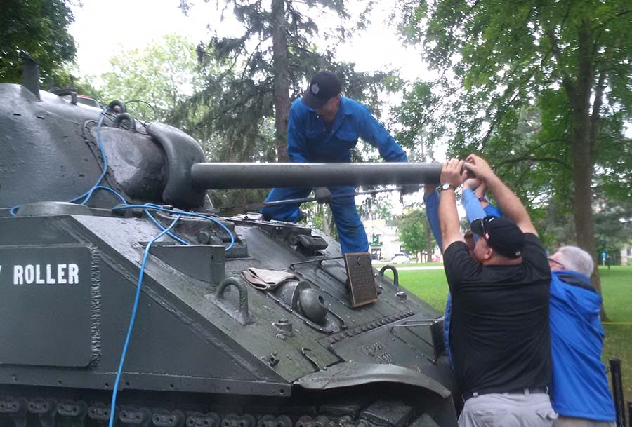 "Members of the 1st Hussars Association move the gun barrel of the ""Holy Roller"" Sherman tank back to a high angle as part of their inspection of the vehicle, a Second World War artifact that has been on display in London, Ontario for over 60 years.