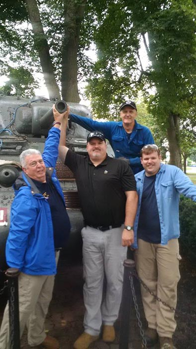 1st Hussars Association members (left to right) Pat O'Hagan, Jason Roome, Fletcher Haley and Perry Kitson stand alongside the Holy Roller during their recent inspection of the vehicle. Photo: provided by Lieutenant-Colonel (Retired) Joe Murray