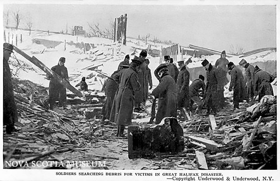 Soldiers searching debris for survivors