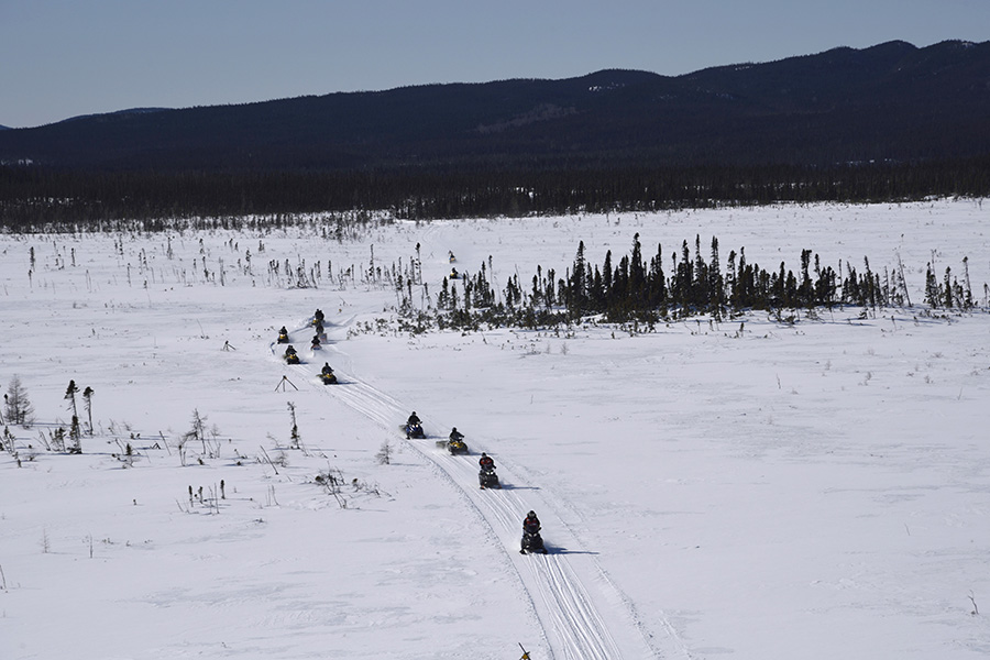 Soldiers from 37 Canadian Brigade Group, 4th Artillery Regiment (General Support), the United States National Guard and Polish Army participating in Exercise NORTHERN SOJOURN transit through rural areas of Labrador on Light Over Snow Vehicles on March 6, 2017 during long range sub-arctic patrols taking place throughout the region. ©2017 DND/MDN