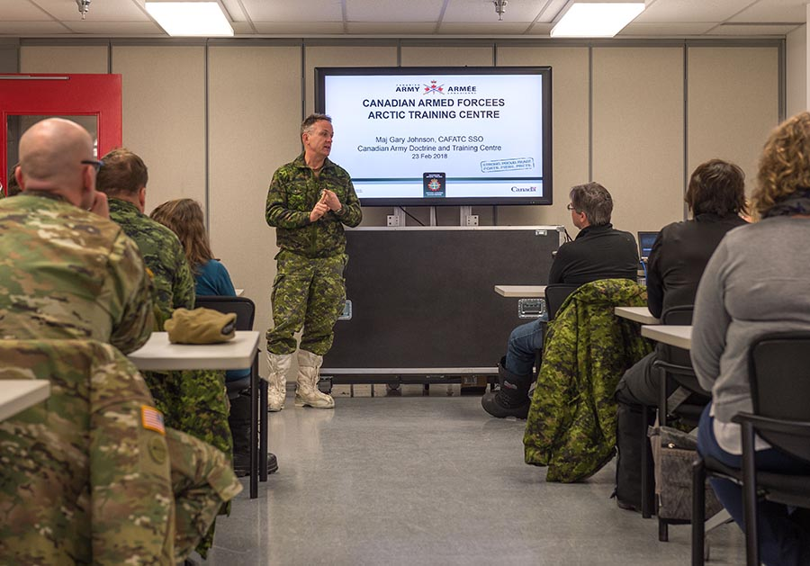 Major General Hetherington, Commander of the Canadian Army Doctrine and Training Centre, speaks during Arctic Operations Advisor training at the Arctic Training Centre in Resolute Bay, Nunavut on February 23, 2018. Photo: Master Corporal Jennifer Kusche, Canadian Forces Combat Camera. ©2018 DND/MDN Canada.