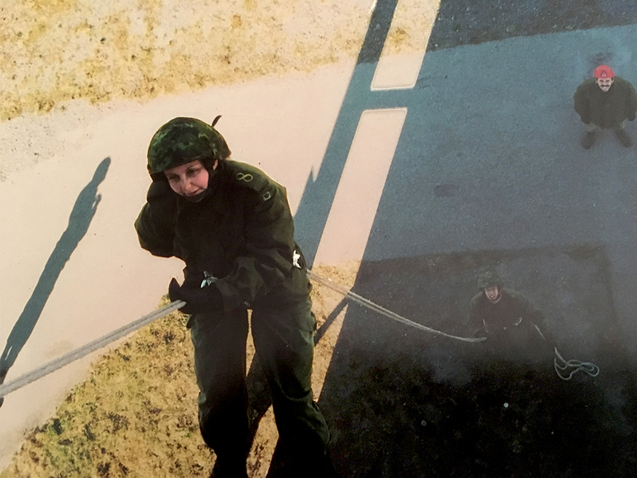 Sergeant Cheryl Crispin (then a Private) rappelling down a wall as part of her Basic Military Qualification course in Esquimalt, British Columbia in 2004. All soldiers are required to complete BMQ, regardless of their trade. Photo: provided by Sergeant Cheryl Crispin, National Defence Quality Assurance Region  (Vancouver).