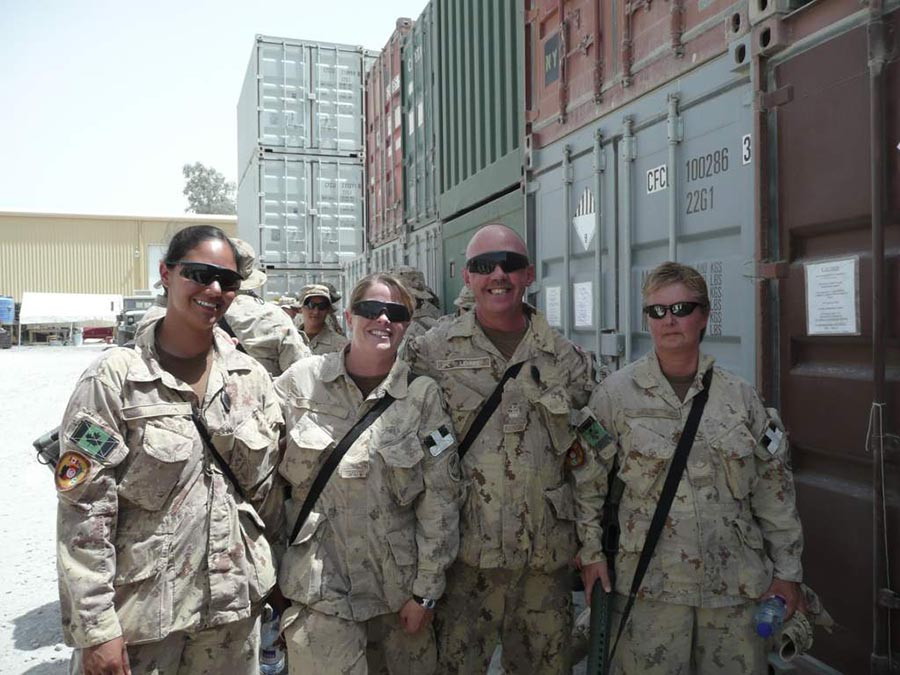 Sergeant Cheryl Crispin (Right) and coworkers stand in front of sea containers during her second deployment to Afghanistan in 2011. Photo: provided by Sergeant Cheryl Crispin, National Defence Quality Assurance Region (Vancouver).