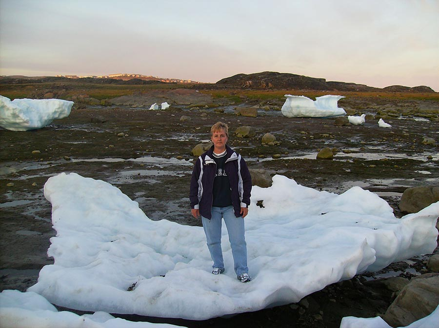 Sergeant Cheryl Crispin stands on a sheet of ice as she explores Iqaluit, Nunavut during her leisure time. She was in Canada's North as part of Operation NANOOK in 2008. Photo: provided by Sergeant Cheryl Crispin, National Defence Quality Assurance Region (Vancouver).