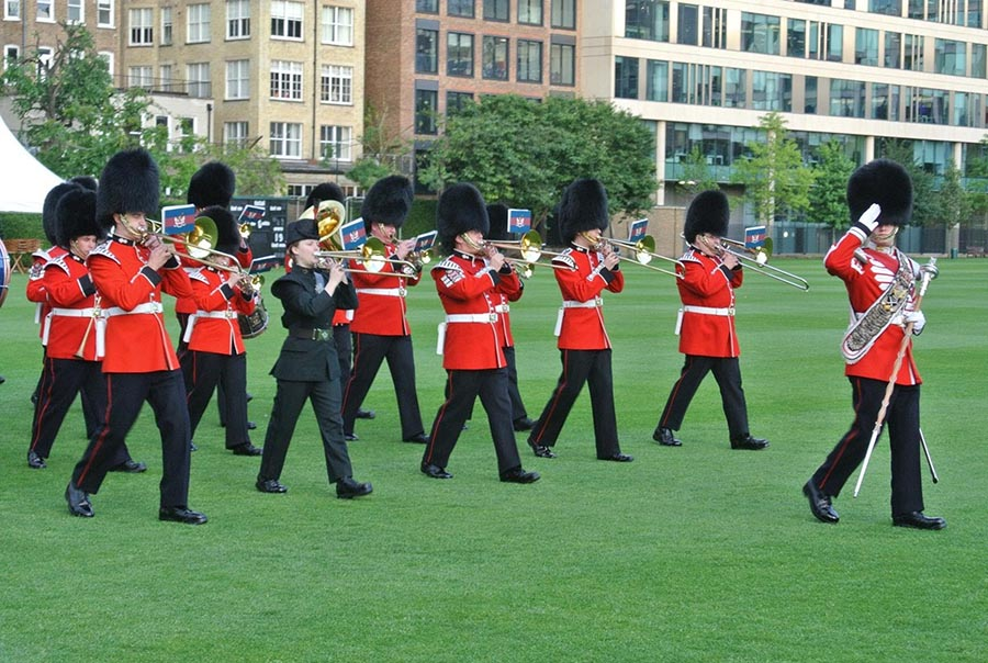 Corporal Samantha Rohringer, in dark-coloured uniform, performs in a parade with the Honourable Artillery Company Band at Finsbury Barracks in London, England during the spring of 2017. Photo: provided by Corporal Samantha Rohringer, Royal Winnipeg Rifles.