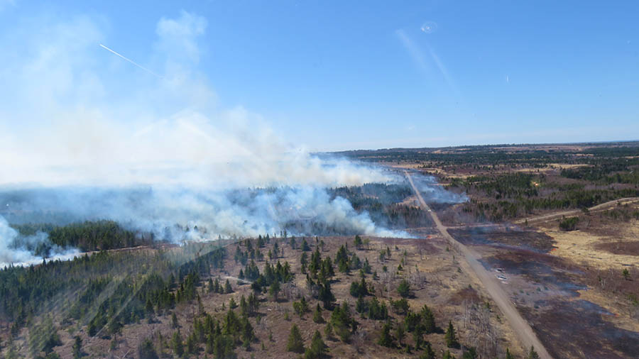 An aerial view of the 2016 spring burn at 5th Canadian Division Support Base Gagetown in New Brunswick. Base staff conduct controlled burns on the base's training area each spring to reduce the risk of uncontrolled fires. Photo: Doug Wilson, Operations Services Branch Gagetown. ©2018 DND/MDN Canada.