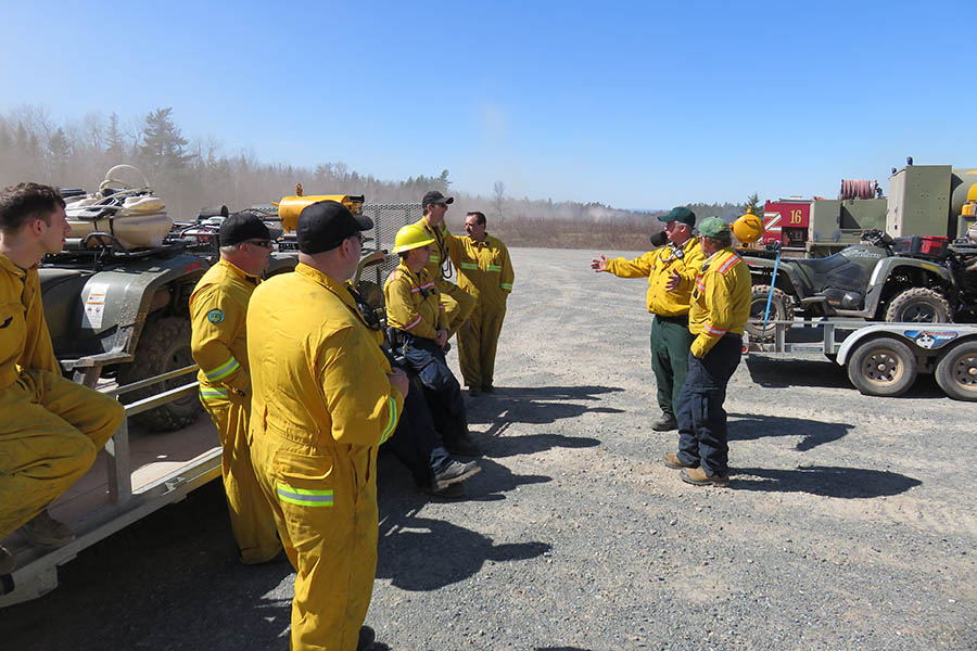 Fire prevention is a high priority at 5th Canadian Division Support Base Gagetown in New Brunswick, where staff carry out controlled burns each spring on the base's Range Training Area. Base staff are pictured during the April 2016 burn. Photo: Doug Wilson, Operations Services Branch Gagetown. ©2018 DND/MDN Canada.