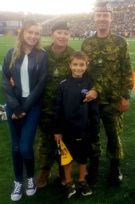 Chief Warrant Officer Tracy-Ann Fisher and her husband Warrant Officer Graeme Fisher with their son Sean and daughter Heather.