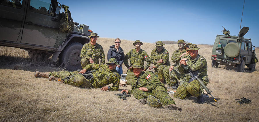 Julie Baines meets Sergeant Taylor Warren's troop during Exercise ARMOURED BISON 2018 held at CFD Dundurn on April 28, 2018. Sgt Warren, a part-time Army Reservist, works full-time as a Border Officer with Canada Border Services Agency.