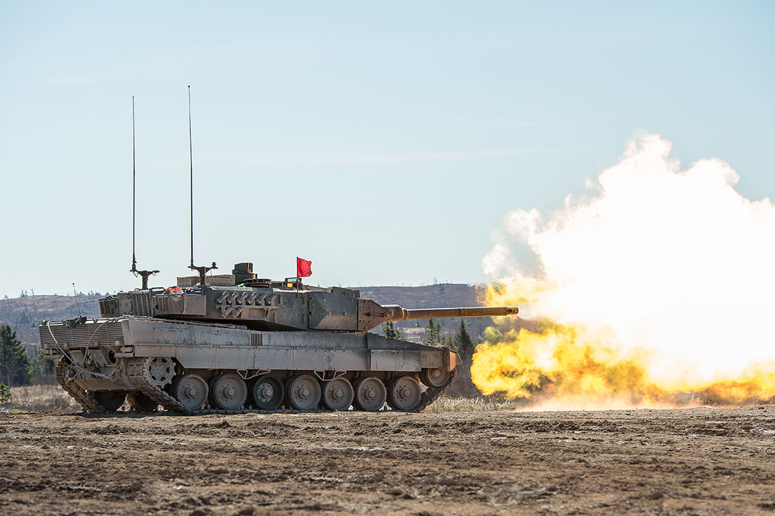 Members of the Royal Canadian Armoured Corps School practice their shooting skills from a Leopard II tank at Firing Point 4