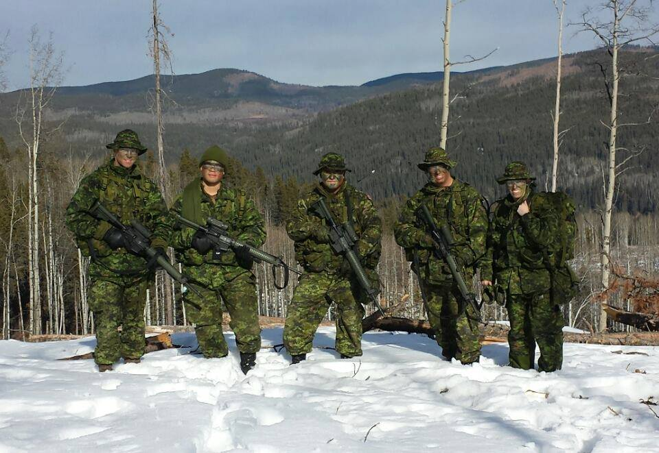 Corporal Scott Sargent (far left) training with fellow members of the Calgary Highlanders