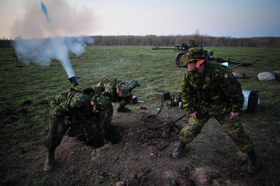 An 81-mm mortar is fired during Exercise IRON TALON in Meaford, Ontario in April 2008. 