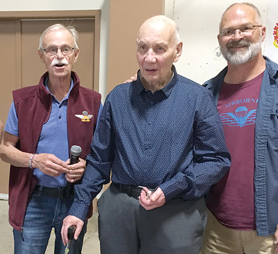 Retired Airborne Gunner Paul Gauci, 92, receives a commemorative Airborne Gunners coin