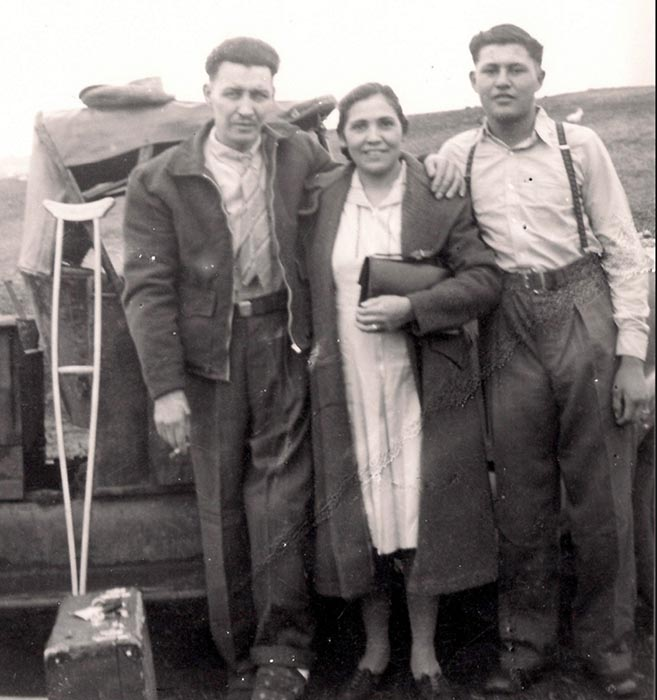 Francis Godon (right), in his teenage years, stands with his parents on their farm in Bossevain, Manitoba. Photo: Provided by the Godon family.