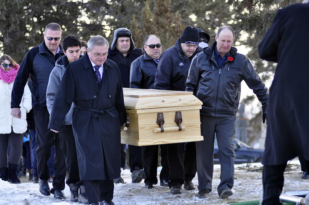 Francis William Godon's coffin is carried by family and friends to his gravesite in Bossevain, Manitoba on January 19, 2019. Photo: Jules Xavier, Shilo Stag.