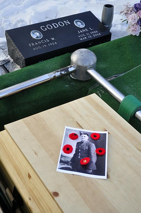 A photo of Francis William Godon, taken in 1942 in North Bay, Ontario, is placed on his coffin with poppies in Bossevain, Manitoba on January 19, 2019. Photo: Jules Xavier, Shilo Stag.