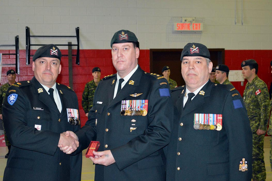 Captain Patrick Lajoie was honoured as part of his Regiment receiving a new Battle Honour for Afghanistan, bestowed on the Regiment on March 9, 2019. Here he receives his Canadian Decoration 2 for 32 years of service on April 8, 2018 from Régiment de la Chaudière commander Lieutenant-Colonel Francois Provost (right) and Regimental Sergeant-Major Chief Warrant Officer Éric Lapalme (left) on April 8, 2018. Photo: ©2018 DND/MDN Canada