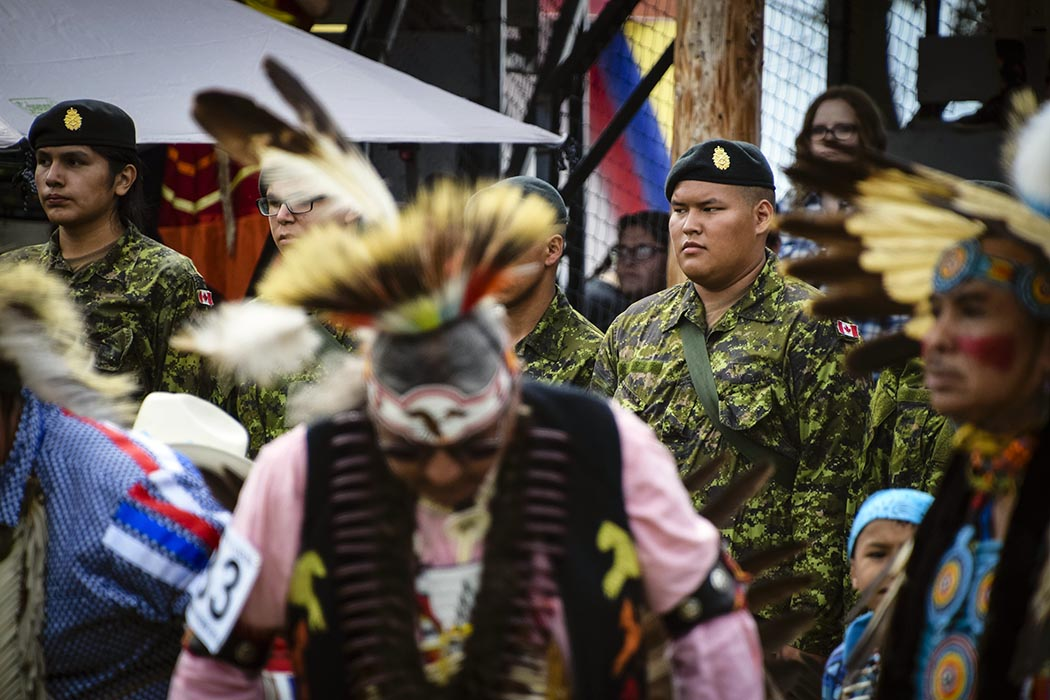 Candidates of Bold Eagle 2018 look on during the Grand Entry of the Poundmaker Pow Wow in St. Albert, Alberta, on August 4, 2018.  Photo: Corporal Jay Ekin, Wainwright Garrison Imaging. ©2018 DND/MDN Canada