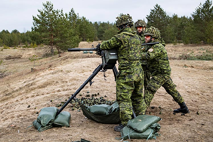 Canadian soldiers train on the tripod-mounted C6 machine gun in Latvia in March 2019. They were counted among 32 candidates from Canada, Spain, Slovakia, Italy, Albania, Poland and Montenegro who participated in the training event to enhance interoperability among Allies working within the enhanced Forward Presence Battle Group Latvia. Photo: Caporal Genevieve Beaulieu, Roto 11, Latvia Imagery. ©2019 DND/MDN Canada.