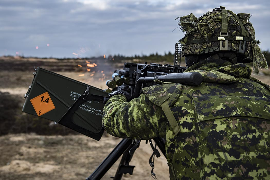 A Canadian soldier fires a tripod-mounted C6 machine gun during training in Latvia in March 2019. This training included seven Allied countries whose members support the enhanced Forward Presence Battle Group Latvia. Photo: Caporal Genevieve Beaulieu, Roto 11, Latvia Imagery. ©2019 DND/MDN Canada.