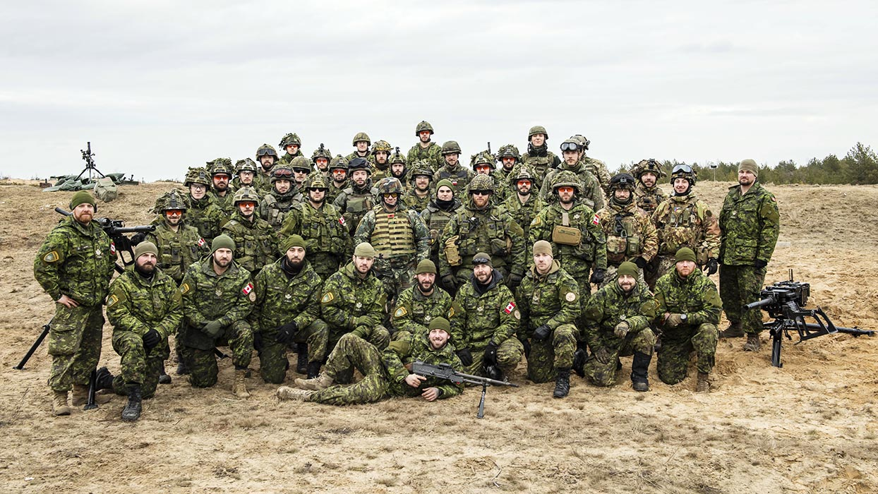 Candidates from seven Allied countries who participated in the DP2 –Weapons Detachment Member exercise with the weapons on which they trained in March 2019 in Latvia – the tripod-mounted C6 machine gun and the C16 grenade launcher. These exercises help to establish a solid foundation for international partnership. Photo: Caporal Genevieve Beaulieu, Roto 11, Latvia Imagery. ©2019 DND/MDN Canada.