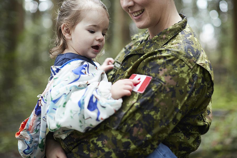 A Canadian Army soldier with her young daughter.