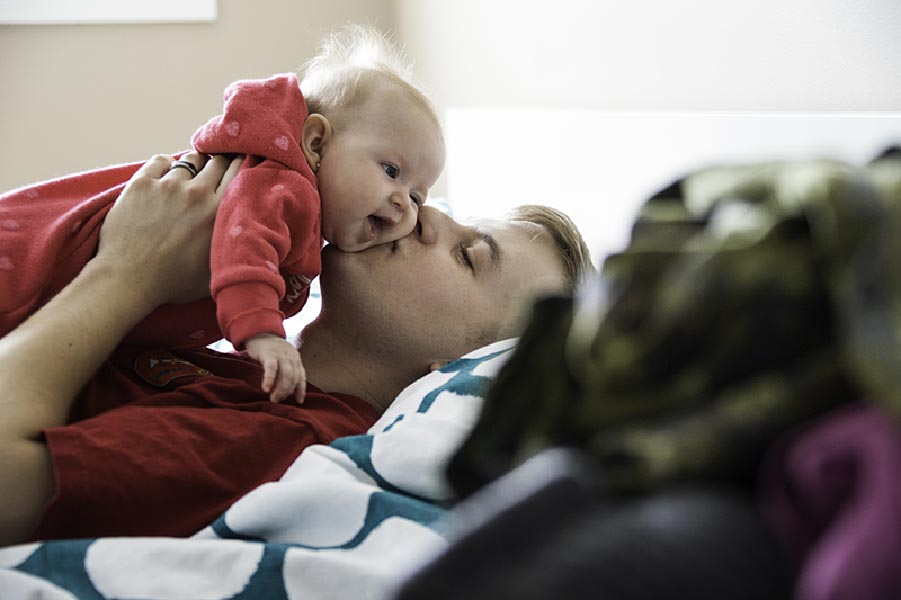 A Canadian Army soldier spends quality time with his baby. A large part of the support network available to soldiers and their families during high readiness training and deployment is the Military Family Resource Centre at each military base in Canada. Photo: Canadian Forces Morale and Welfare Services. ©2018 DND/MDN Canada.