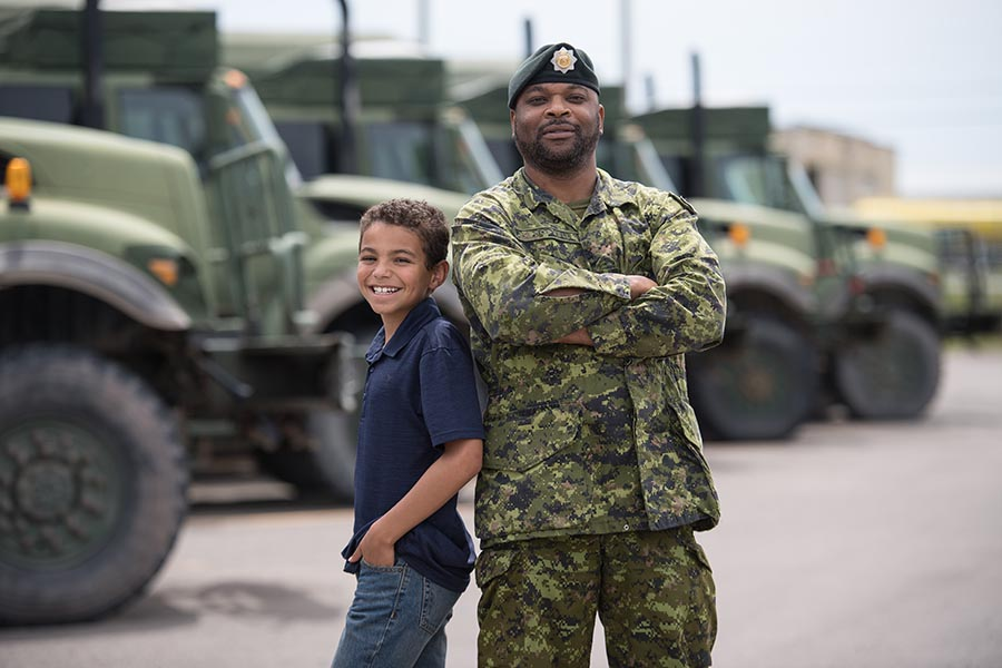 A Canadian Army soldier with his young son. Effective soldiers need support on many levels – on deployment, during training – and so do their family members. Photo: Corporal Geneviève Lapointe, Combat Training Centre. ©2018 DND/MDN Canada.