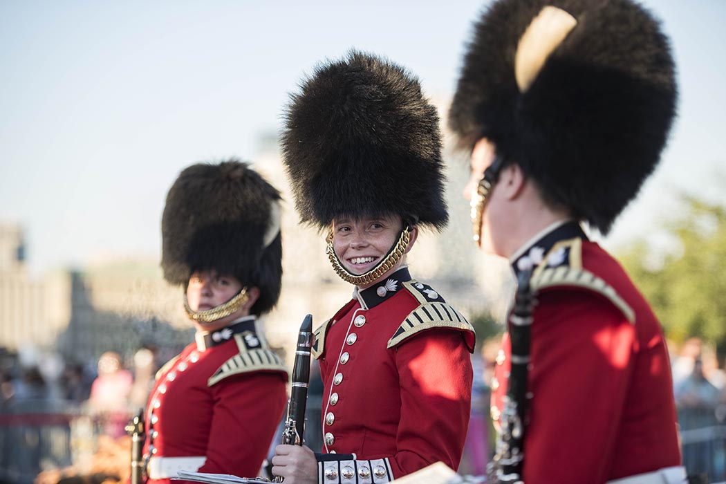 Wearing their famous bearskin hats, female members of the Ceremonial Guard share a moment before performing in Fortissimo on the lawns of Parliament Hill in Ottawa, Ontario in July 2018. Photo: Ordinary Seaman Camden Scott, Army Public Affairs. ©2018 DND/MDN Canada.