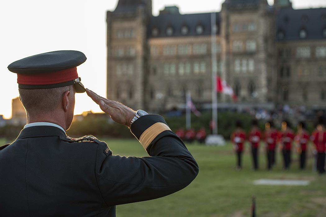 Lieutenant-General Jean-Marc Lanthier, Commander of the Canadian Army, salutes on the dais during the annual Fortissimo event on Parliament Hill in Ottawa, Ontario on July 19, 2018. Photo: Ordinary Seaman Camden Scott, Army Public Affairs. ©2018 DND/MDN Canada.