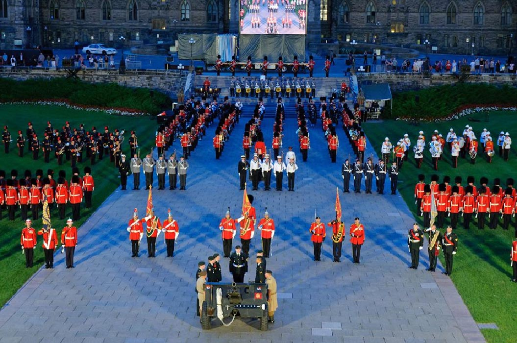 A closing scene of the Fortissimo military sunset ceremony on Parliament Hill in Ottawa, Ontario in July 2018. Photo By: Ordinary Seaman Camden Scott, Army Public Affairs. ©2014 DND/MDN Canada.