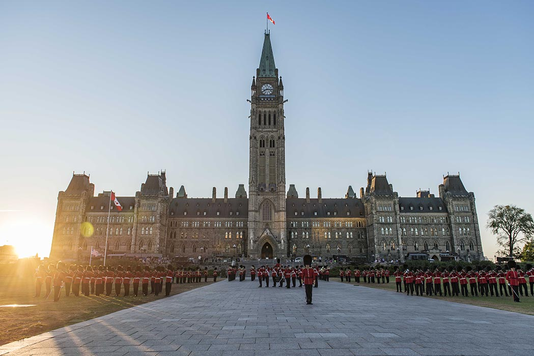 Members of the Ceremonial Guard prepare to march off as the sun sets during the annual Fortissimo event on Parliament Hill in Ottawa, Ontario on July 19, 2018. Photo: Ordinary Seaman Camden Scott, Army Public Affairs. ©2018 DND/MDN Canada.