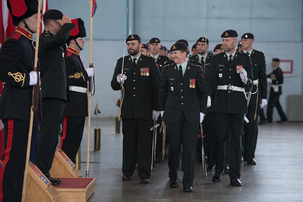 Lieutenant-Colonel Kathy Haire leads The Royal Canadian Regiment of Artillery School in a march-past for the first time as the Commandant, with outgoing commandant Lieutenant-Colonel Nickolas Roby saluting the soldiers on parade on June 21, 2019 at 5th Canadian Division Support Base Gagetown, Oromocto, New Brunswick. Photo: Corporal Geneviève Lapointe, Combat Training Centre. ©2019 DND/MDN Canada.