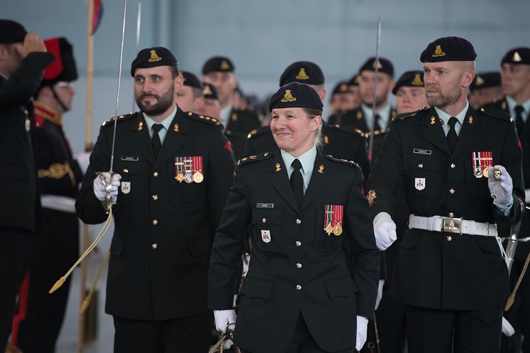 Incoming Commandant of The Royal Canadian Regiment of Artillery School (RCAS) Lieutenant-Colonel Kathy Haire (centre) during her first march-past as Commandant following the Change of Command ceremony on June 21, 2019 at 5th Canadian Division Support Base Gagetown, Oromocto, New Brunswick accompanied by Chief Warrant Officer Robert Francis, Regimental Sergeant Major of the RCAS (right) and Captain Nick Morris, Adjutant of the RCAS (left). Photo: Corporal Geneviève Lapointe, Combat Training Centre. ©2019 DND/MDN Canada.