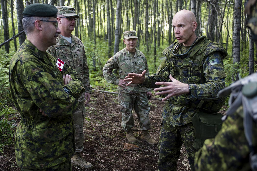 Brigadier-General Wayne Eyre (right) assumed command of 3rd Canadian Division on July 18, 2014 in Edmonton. Now holding the rank of Lieutenant-General, he officially stepped into the role of Commander Canadian Army on August 20, 2019. Photo: Robert Schwartz, 3rd Canadian Division Support Group Edmonton. © 2014 DND-MDN Canada.