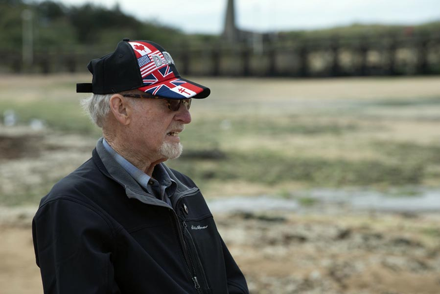 Second World War Veteran Russell Kaye has a reflective moment as he stands on Juno Beach for the first time since he landed there on June 6, 1944 as a young soldier on D-Day. Photo: John's Photography, Sooke, BC