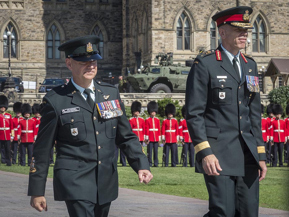 Lieutenant-General Wayne Eyre, (right) incoming Commander of the Canadian Army, and Chief Warrant Officer Stuart Hartnell, (left) Canadian Army Sergeant Major, return to their seats during the Canadian Army Change of Command ceremony on Parliament Hill in Ottawa, Ontario on August 20, 2019. Photo: Sergeant Lance Wade, 5th Canadian Division. ©2019 DND/MDN Canada.