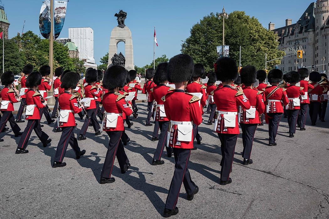 The Ceremonial Guard Band parades up Elgin Street in Ottawa, Ontario, passing in front of the National War Memorial and the Tomb of the Unknown Soldier on the way to Parliament Hill during the Changing of the Guard ceremony on July 9, 2019. Photo: Able Seaman Camden Scott, Army Public Affairs. ©2019 DND/MDN Canada.