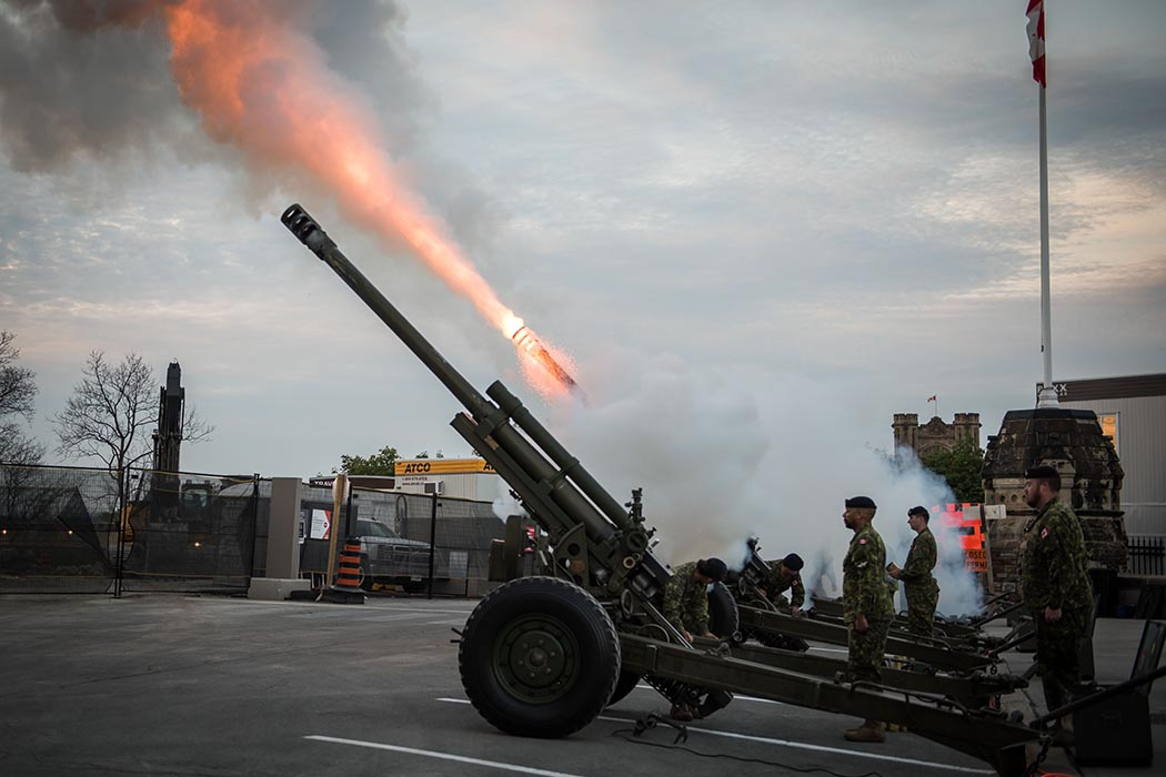 "Artillery guns are fired by the 30th Field Regiment of the Royal Canadian Artillery during a live performance of Tchaikovsky's ""1812 Overture"" at Fortissimo on Parliament Hill in Ottawa, Ontario on July 18, 2019. Photo: Ordinary Seaman Alexandra Proulx, Army Public Affairs. ©2019 DND/MDN Canada."